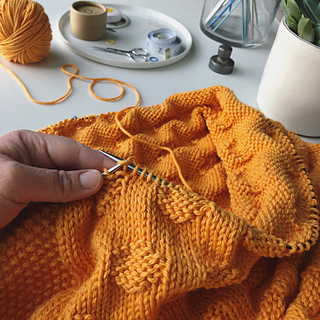 Knit in one piece on long circular needles.