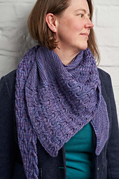 Learn to knit reversible cables with this luxurious shawl.