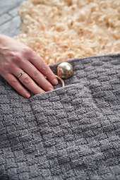 This beautiful blanket will teach you how to work an i-cord cast off, and features a cute pocket detail.