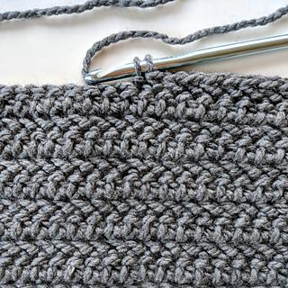 Herringbone half double crochet close up- it looks like little arrows!