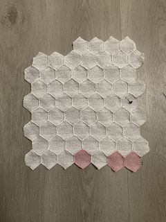 Small hexagons connected together, representing data from January and February 2020. There are 57 white hexagons and 3 light pink hexagons.