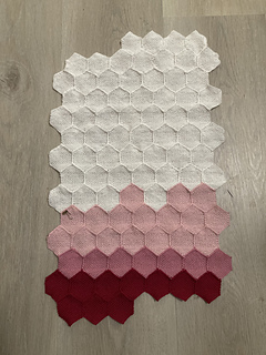Data from January, February, and March. Small hexagons connected together in 14 rows of 7 (first and last row do not have 7). Top half of the hexies are white then fade through two different shades of pink to red in the bottom half.