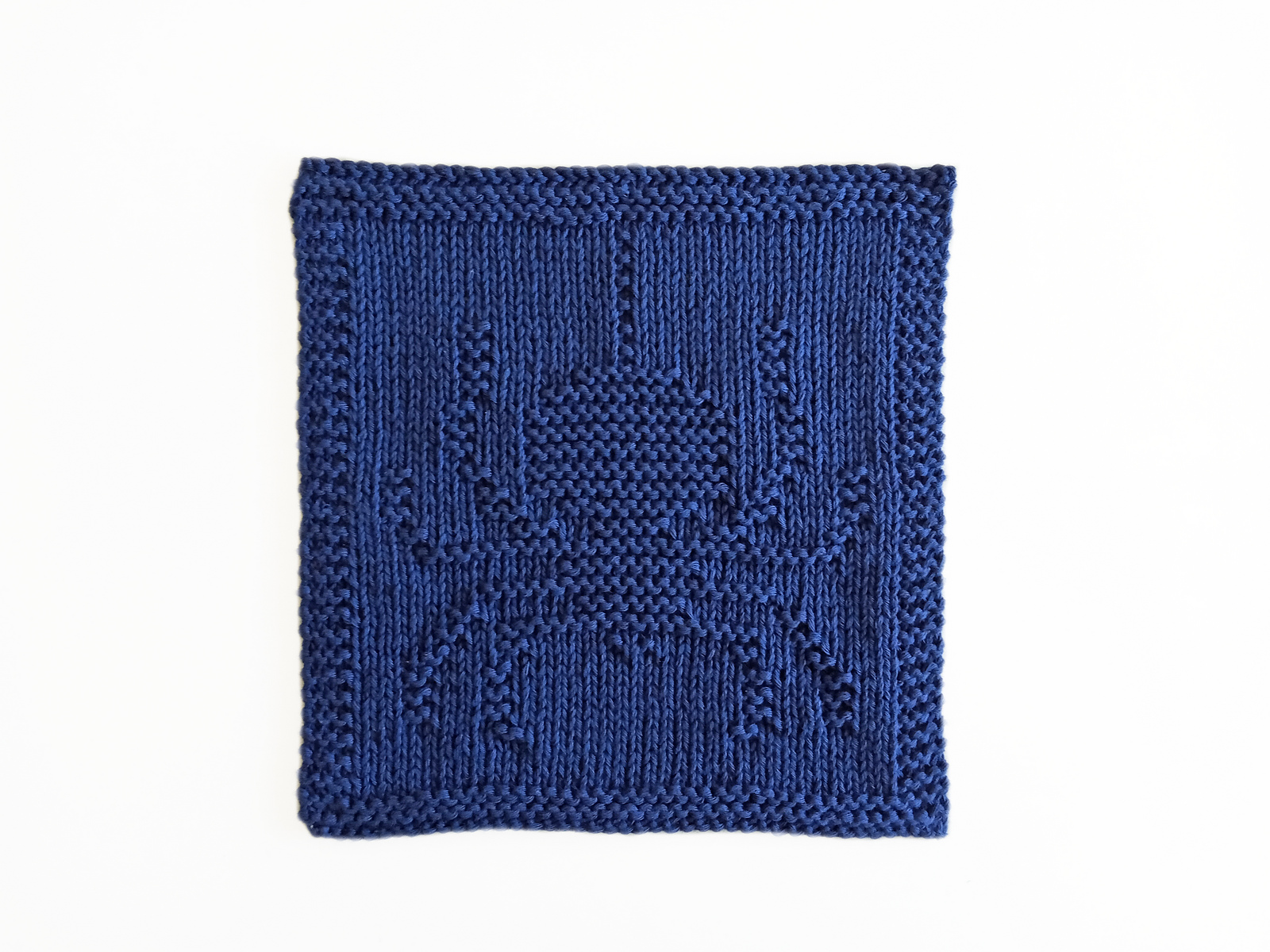 Halloween spider hand knitted washcloth pattern in knits and purls