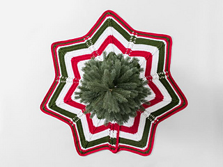 Classic Cable Star Christmas Tree Skirt made with Sprightly Acrylic Yarn