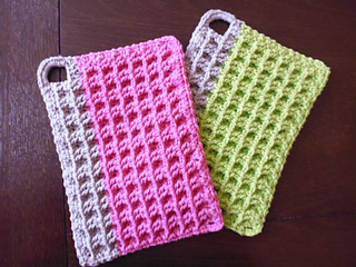 pair of waffled potholders with vertical bar