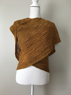 Knit with 2 skeins of fingering weight yarn. Modified to have looser edge stitches.