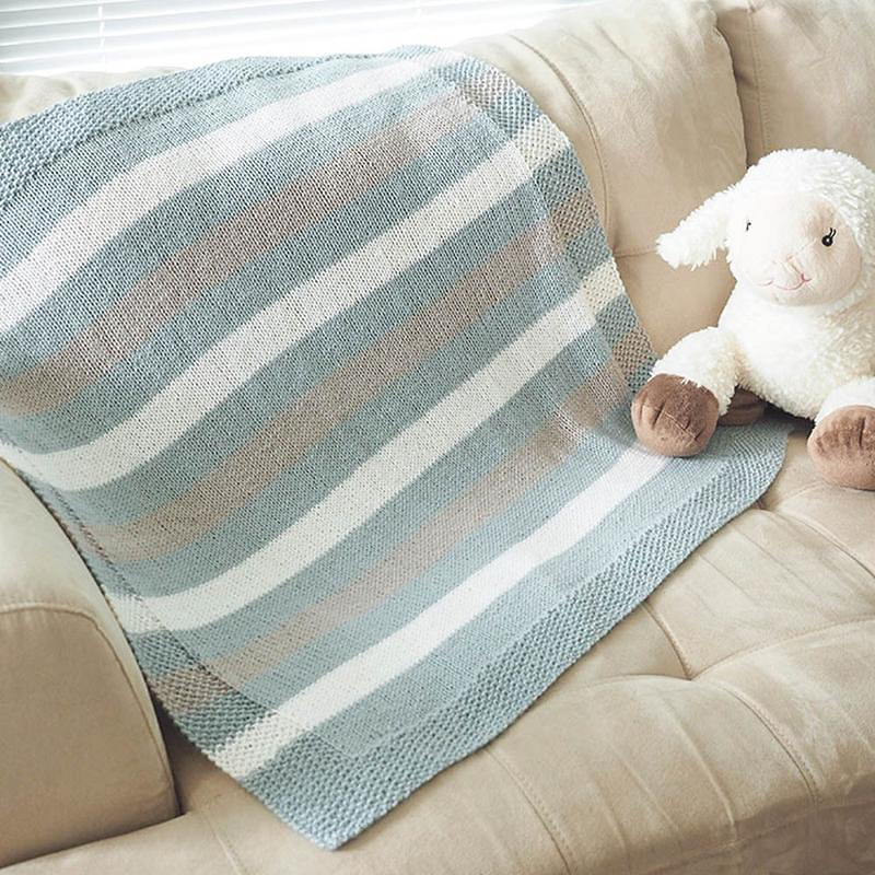 knit this easy striped baby blanket for a new baby gift with dk weight yarn
