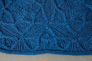 This is an edge half-hexagon. These are knitted and then joined in a strip for the ends of the blanket.