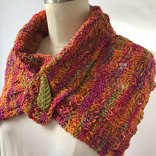 Bulky Flat Collar in Merino Ribbon.  Closed here with a shawl pin.  See pattern for Button Collage.