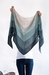 From end to end, the shawl measures 220 cm. and is rougly 70 cm. wide.