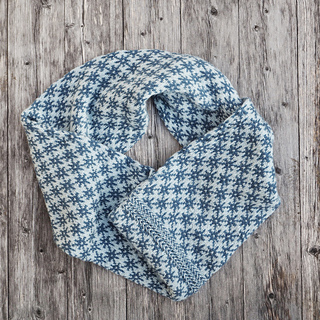 The Trondheim Cowl, size 2, wraps around your neck twice.