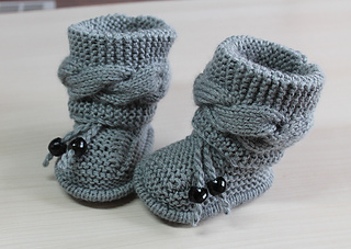 Ravelry: Baby booties cable pattern by