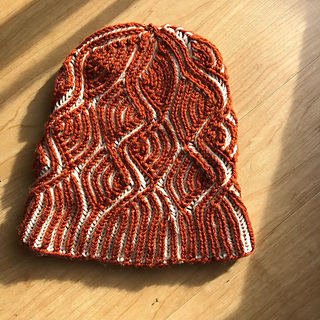 Hat shown is Medium Size on size 4 needles, 1 size smaller than pattern recommended.