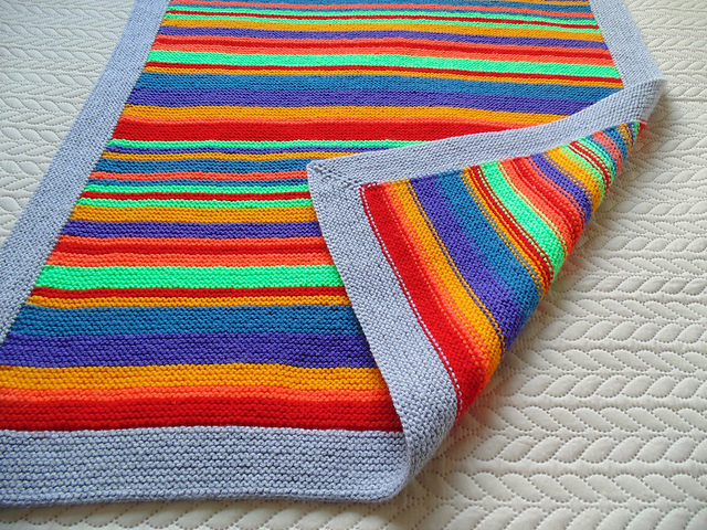 Colorful stripes baby blanket using scrap yarn with picked up stitches to knit mitred corner
