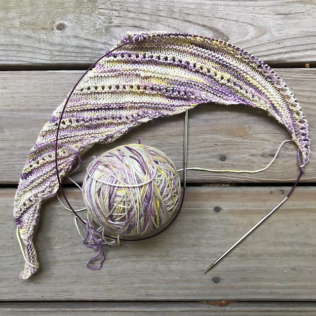 Image: a partially knitted shawl and a ball of yarn