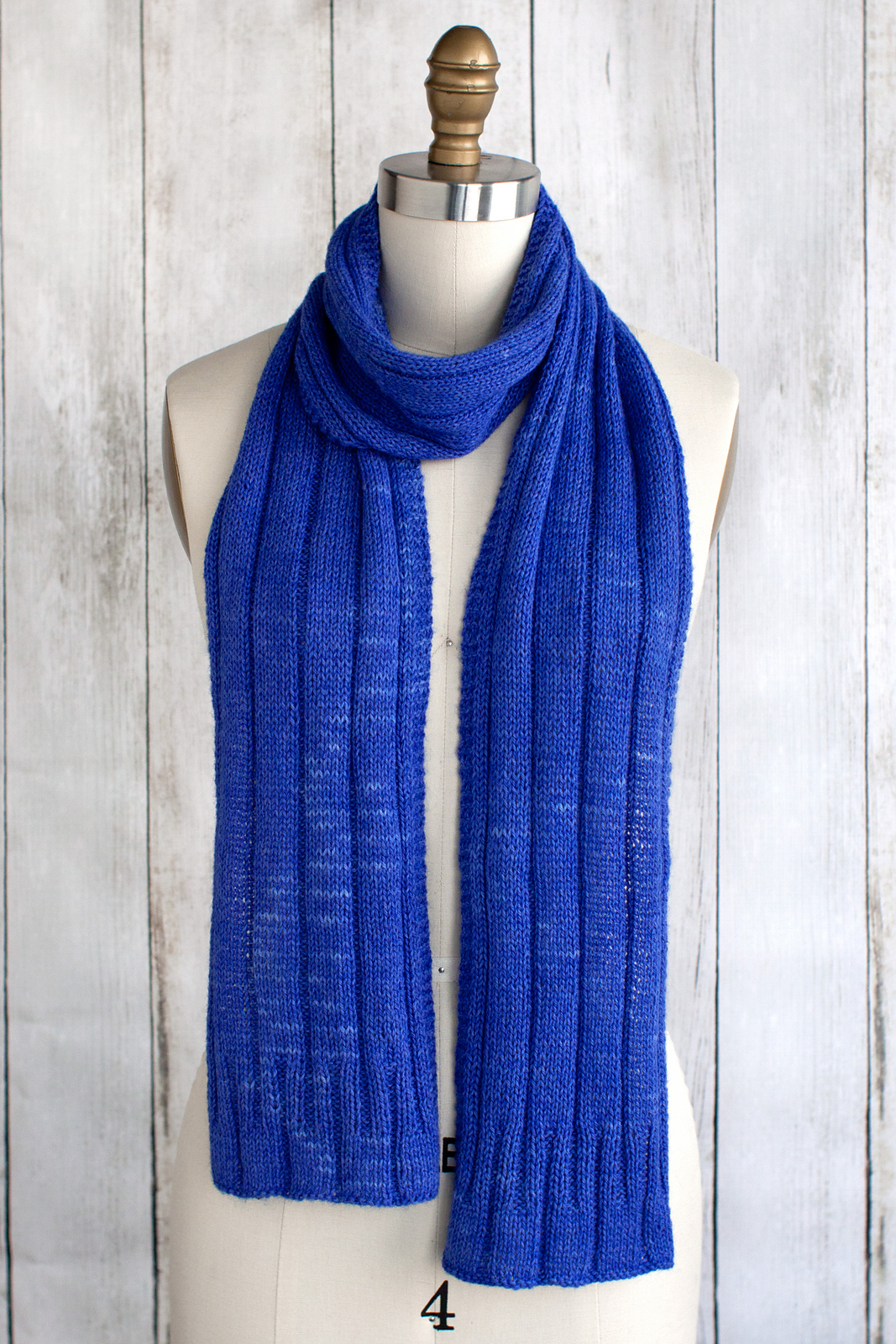 vibrant blue knitted scarf in simple knits and purl pattern
