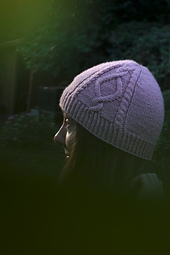 Alina Hat shown from side with cable panel moved to the side