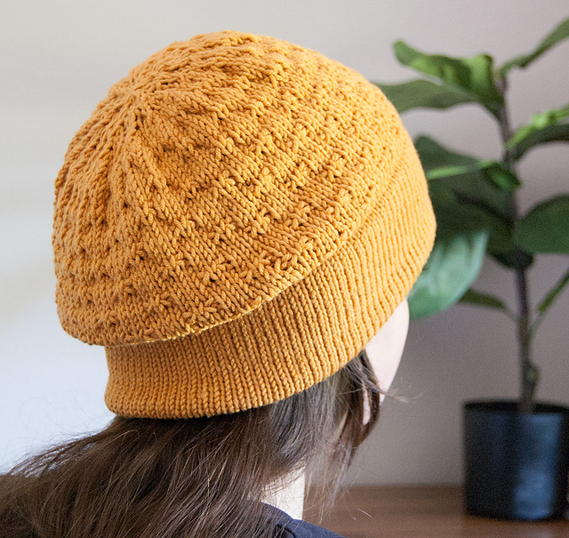 Double brim knitted hat pattern using DK weight yarn.