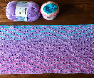 Small size blanket after Row 34 in Lion Brand Mandala yarn in Liger as Yarn B and Bernat Baby Sport in Lavender as Yarn A.