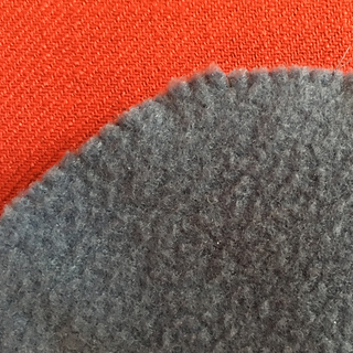 close up of polar fleece liner showing hand-sewing