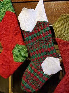 Stocking made of variegated sock yarn with contrast top and heel.