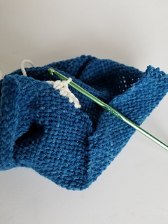 Wrong side facing towards you, work a row of single crochet along the top edge.