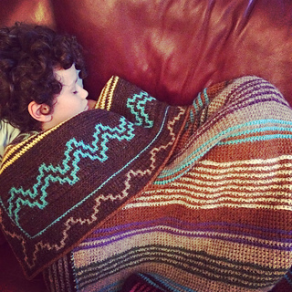 here you can see the backside of the blanket (and my son snuggling under it)