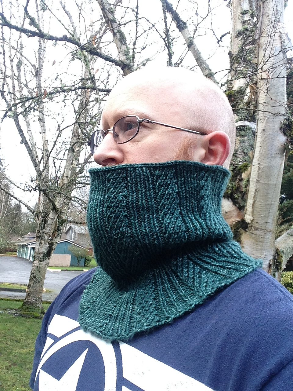 Knit and purl cowl pattern using worsted weight yarn on circular knitting needles.