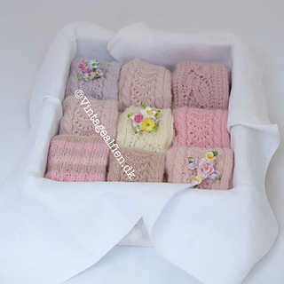 The white gloves  in the middle and the pair up in right corner are knitted in the pattern Princess T