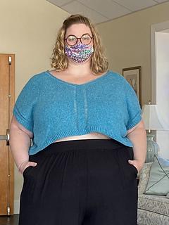 """65"""" garment on 56"""" chest, body length knit to 8"""" before upper body split."""