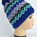 Scandinavian style unisex hat with pompom pattern