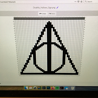 Used Photoshop to sketch up the Deathly Hallows, then chart-minder.com to plot the stitches.