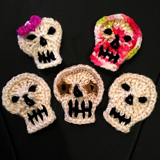 """20-peg Skullies. The pink bow Skully was made on KB SockLoom2; all others were made on CW 20-peg 3/8"""" gauge round loom."""
