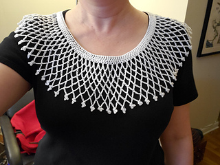"Customer photo. If you are familiar with picot stitches, here is a beautiful modification to the original pattern.  She added a few more chains to the mesh work and then added picot stitches to the final round more reminiscent of the collar that RBG wore & referred to as ""her favorite""."