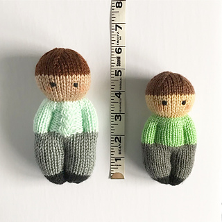 Doll on the left is knit in worsted weight on 3.25mm; doll on the right is knit in DK on 2.75mm