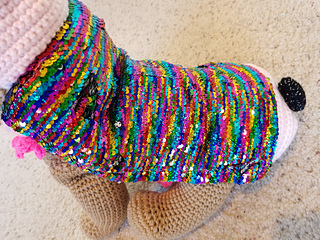 I show how to place sequins on the back of the crochet small panda pet outfit!