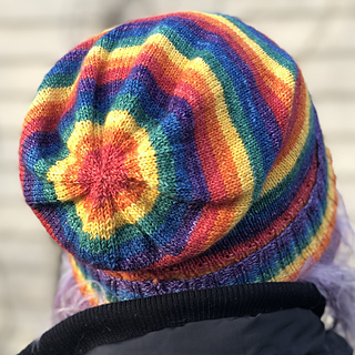 The view of the back of a slouchy hat showing concentric rainbow rings.