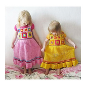 Made by Rion: https://www.ravelry.com/projects/rion/granny-square-toddler-dress-2