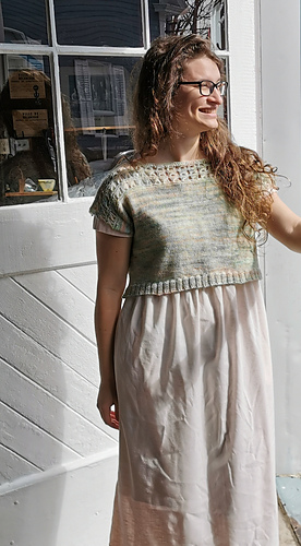 "Size 43"" shown on a 38.5"" model. Knit with  Julie Asselin Leizu Fingering Simple"