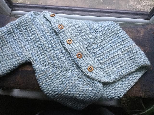 A Baby Surprise Jacket knitted in Light Blue Bo Peep yarn