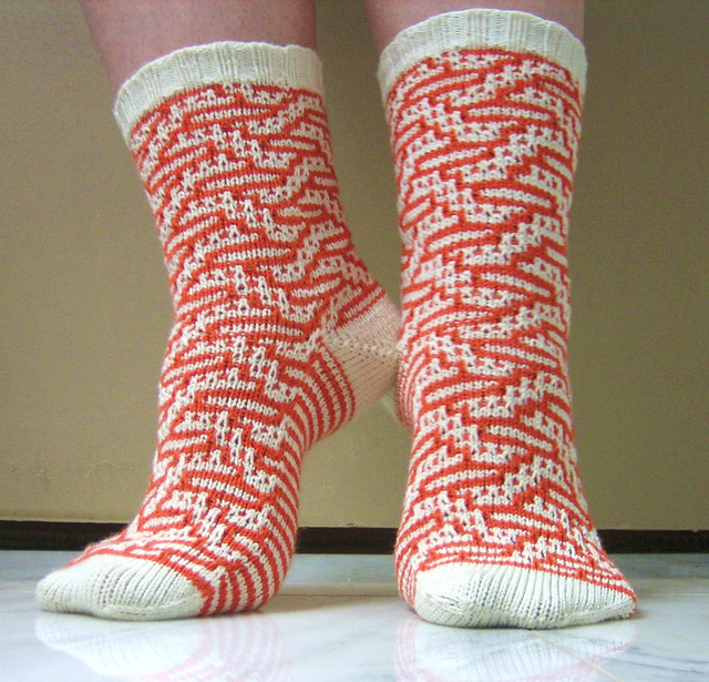 mosaic knitted socks in red and white.