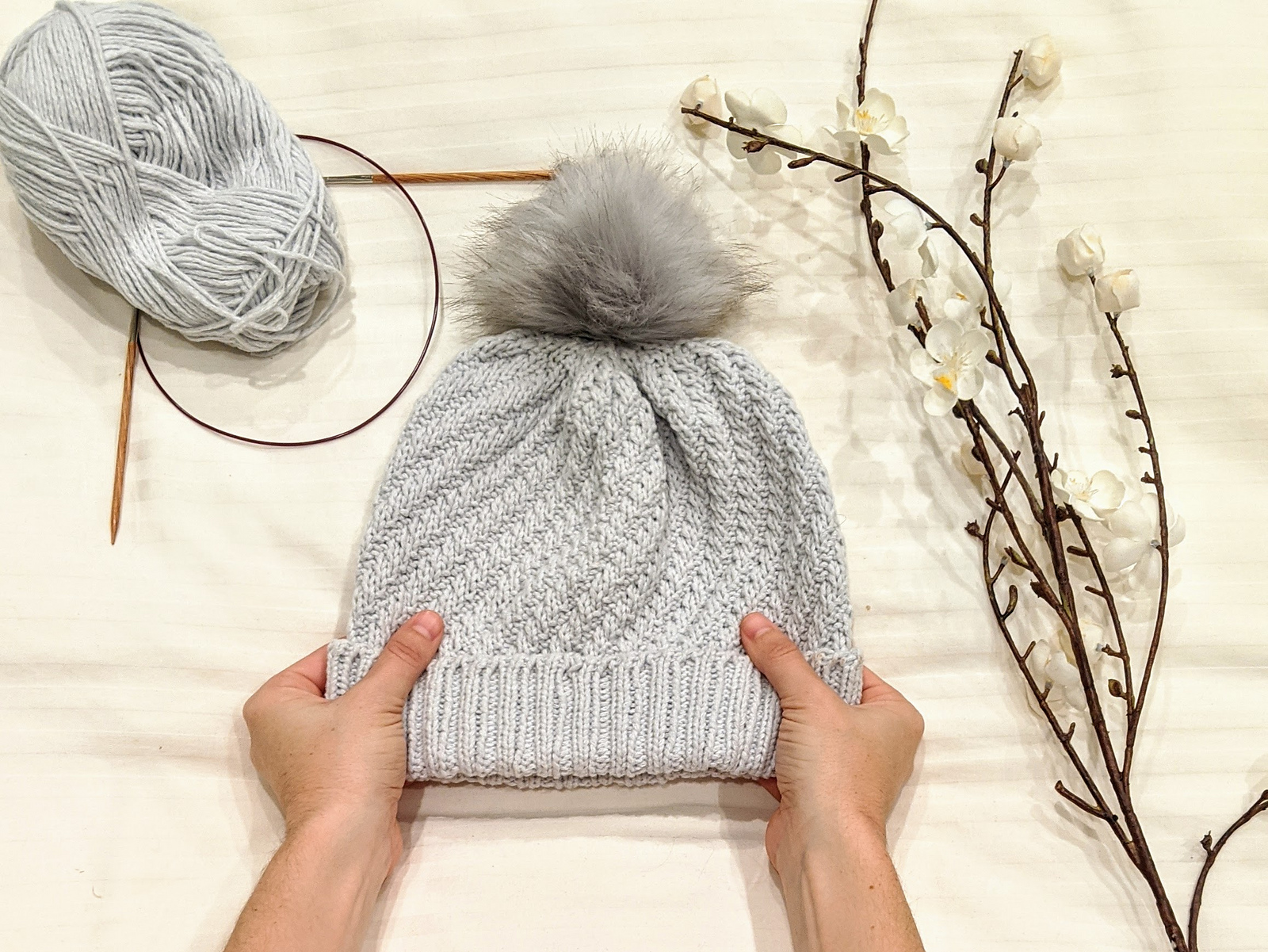 knit hat with using diagonal rib stitch in the round and rib knit brim.