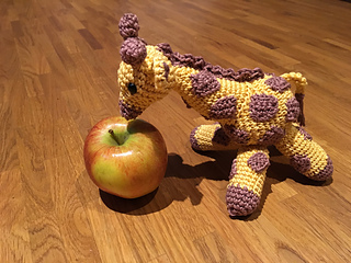 Giraffe and apple