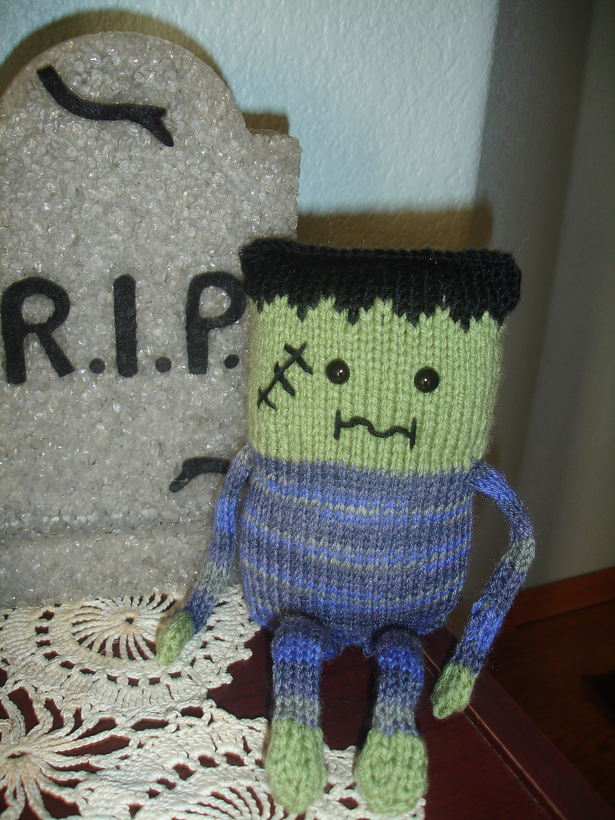 hand knit Frankenstein toy in solid colors and medium weight acrylic yarn
