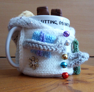 Snowman Left Handed Mug Cozy with biscuits in hood