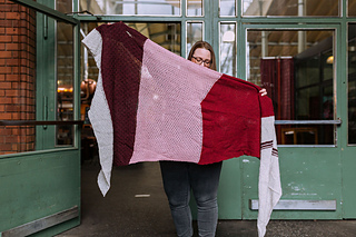It features five sections - four textured and / or simple lace ones, and a fun stripe. You can choose to work the stitch patterns as written up, or insert your own stitch pattern!