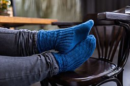 Lena wears Ribb-Party, a cuff-down ribbed sock that hugs your foot!