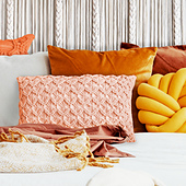 Photo of orange bedroom by Photographee.eu and available from Shutterstock, Photoshopped by Erin Black.