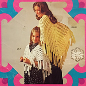 Lily is the white shawl worn by the child.