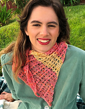 Model wearing cowl sized flying above scarf in peach and yellow